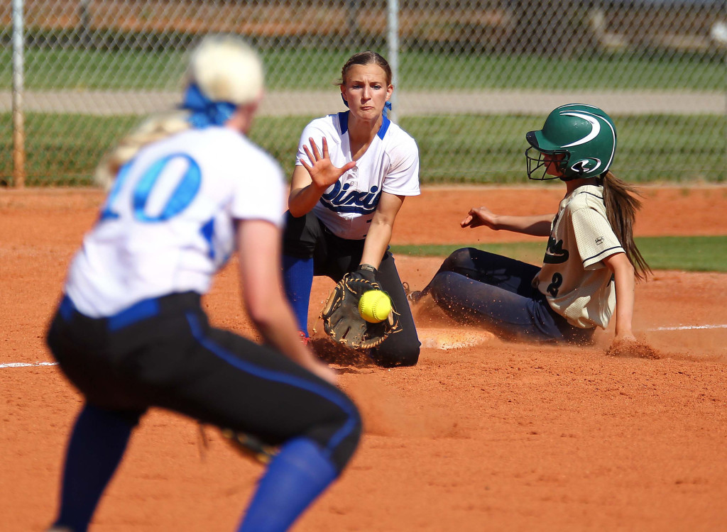 Dixie third baseman Stacia Gelter takes the throw as Snow Canyons Brittney Reyes slides in safely, Snow Canyon vs. Dixie, Softball, St. George, Utah, Apr. 21, 2015 | Photo by Robert Hoppie, ASPpix.com, St. George News