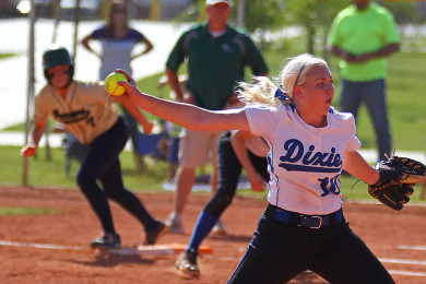 Dixie pitcher Summer Simkins (10) delivers a pitch as Snow Canyon's Shelbee Hutchings gets ready to lead off from first base, Snow Canyon vs. Dixie, Softball, St. George, Utah, Apr. 21, 2015 | Photo by Robert Hoppie, ASPpix.com, St. George News