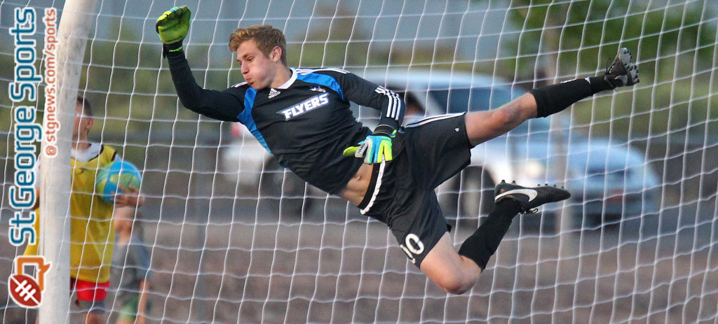 Dixie goalkeeper Ethan Poulton dives for a save, Dixie vs. Snow Canyon, Soccer, St. George, Utah, Apr. 21, 2015   Photo by Robert Hoppie, ASPpix.com, St. George News