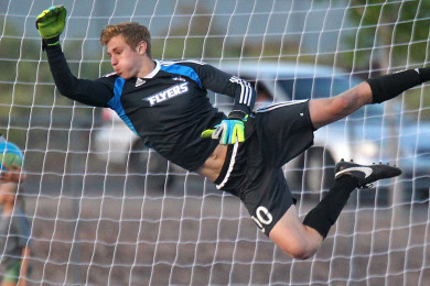 Dixie goalkeeper Ethan Poulton dives for a save, Dixie vs. Snow Canyon, Soccer, St. George, Utah, Apr. 21, 2015 | Photo by Robert Hoppie, ASPpix.com, St. George News