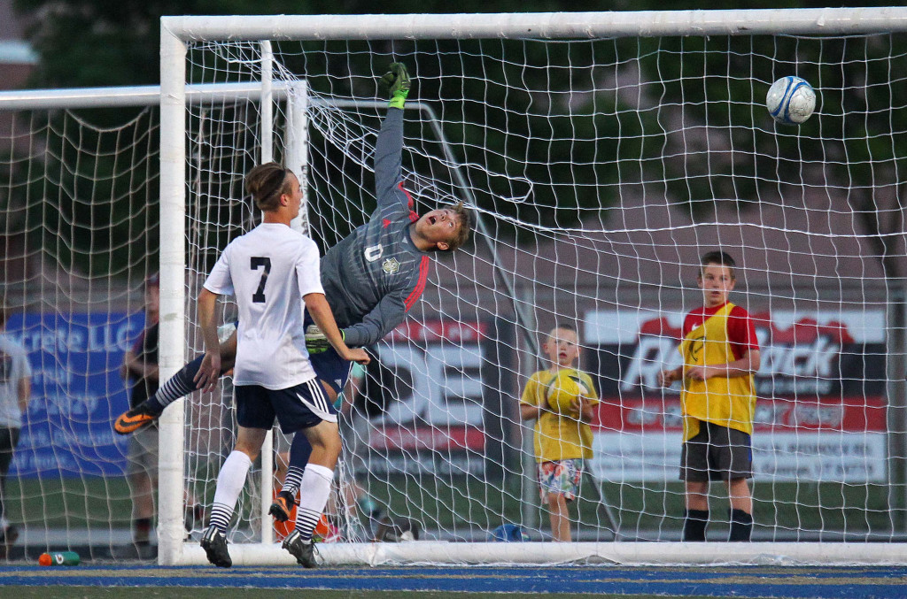 Warrior goalkeeper Braydon Brough leaps as the ball flies past him for a Dixie goal, Dixie vs. Snow Canyon, Soccer, St. George, Utah, Apr. 21, 2015 | Photo by Robert Hoppie, ASPpix.com, St. George News