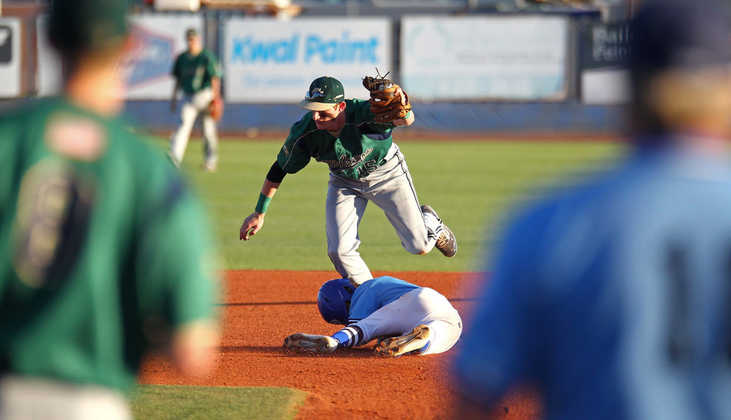 Warrior shortstop Brad Grisenti (15) tags out Dixie's Hobbs Nyberg on a steal attempt, Snow Canyon vs. Dixie, Baseball, St. George, Utah, Apr. 27, 2015 | Photo by Robert Hoppie, ASPpix.com, St. George News