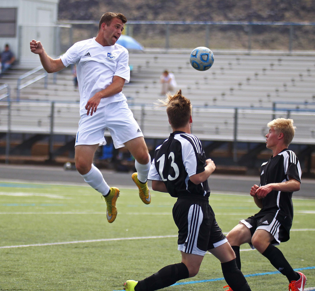 McLane Keenan with a header for the Flyers, Dixie vs. Union, Soccer, St. George, Utah, Apr. 30, 2015 | Photo by Robert Hoppie, ASPpix.com, St. George News