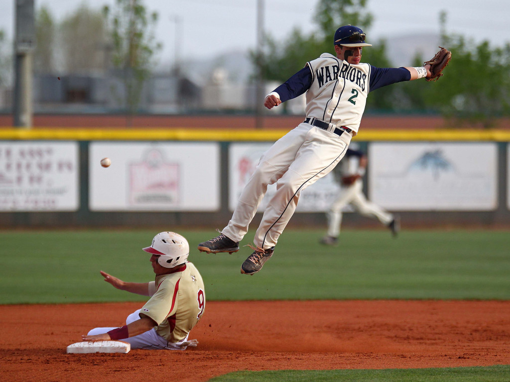 Snow Canyon second baseman Nick Dolce (2) leaps for a high throw as Cedar's Rykker Tom (9) steals second base, Cedar vs. Snow Canyon, Baseball, St. George, Utah, Apr. 1, 2015 | Photo by Robert Hoppie, ASPpix.com, St. George News