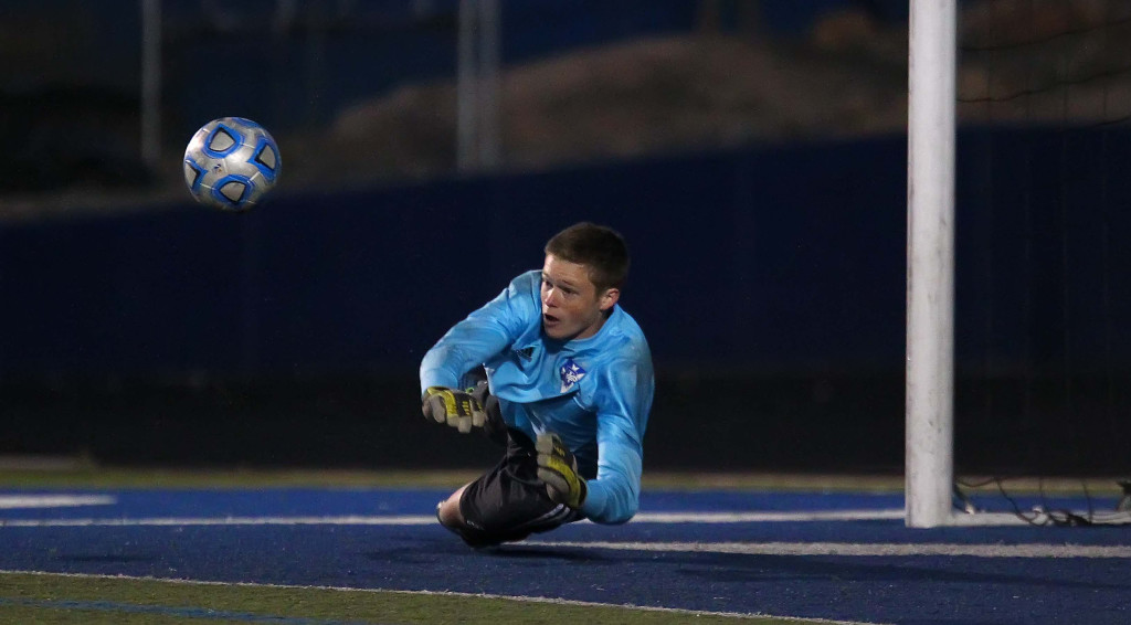 Dixie goalie Bridger Wright makes a save early in the second half, Snow Canyon vs. Dixie, Soccer, St. George, Utah, Apr. 2, 2015 | Photo by Robert Hoppie, ASPpix.com, St. George News