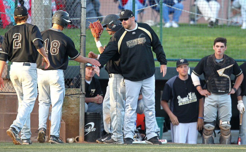 Thunder head Coach Jerry Beck congratulates Chad Nelson (18) after scoring the first run of the game, Desert Hills vs. Snow Canyon, Baseball, St. George, Utah, Apr. 7, 2015 | Photo by Robert Hoppie, ASPpix.com, St. George News