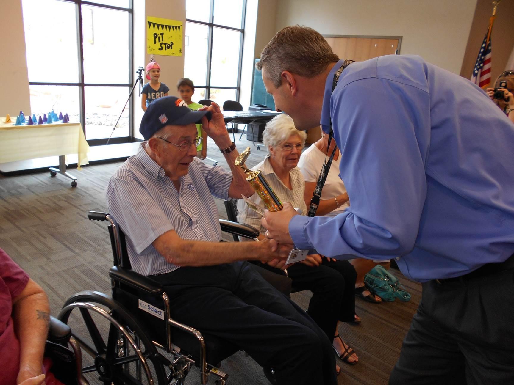 Al Giles awarded as winner of the Southern Utah Veterans Home Pinewood Derby, Ivins, Utah, circa April 2014 | Photo courtesy of Southern Utah Veterans Home, St. George News