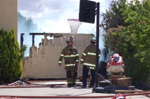Firemen respond to a structure fire located at 1568 N. Hilltop Dr. in Santa Clara, Utah, April 8, 2015 | Photo by Hollie Reina, St. George News