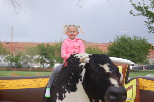 Adyson Christensen rides the mechanical bull at the Southern Utah Culinary Festival held at Vernon Worthen Park, St. George, Utah, April 24, 2015 | Photo by Hollie Reina, St. George News