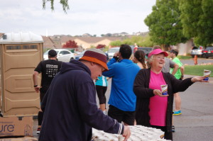 Volunteers hand out fuel and beverages during the Southern Utah Half Marathon, St. George, Utah, April 25, 2015 | Photo by Hollie Reina, St. George News