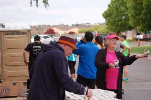 Volunteers hand out fuel and beverages during the Southern Utah Half Marathon, St. George, Utah, April 25, 2015 | Photo by Hollie Reina, St. George News