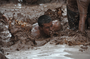 Man swimming through the mud during the Great Race, St. George, Utah, date unspecified | Photo courtesy of Dixie State University, St. George News