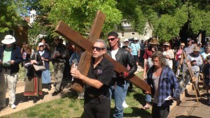 Solomon's Porch Foursquare Fellowship  Pastor Jimi Kestin carries a cross in the Stations of the Cross walk, St. George, Utah, April 3, 2015 | Photo by Holly Coombs, St. George News