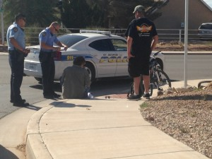 St. George Police officers investigate a collision between a bicycle and a passenger car, St. George, Utah, April 2, 2015 | Photo by Holly Coombs, St. George News