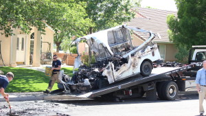 Emergency responders and neighbors examine the remains of a mail truck after a fire, St. George, Utah, April 21, 2015 | Photo by Devan Chavez, St. George News