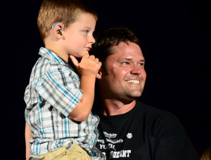 Justin Osmond with a hearing-impaired boy at the Utah Pioneer Days celebration, July 2012, West Jordan, Utah | Photo courtesy of Justin Osmond, St. George News