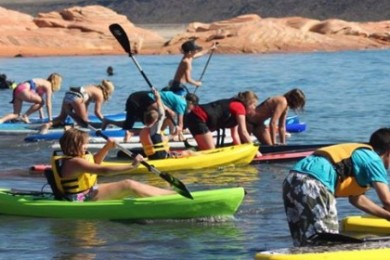 Kayakers and paddleboarders take off at Sand Hollow Reservoir, Hurricane, Utah, date not specified | Photo courtesy of DIG Paddlesports Kayak and SUP Rentals, St. George News