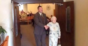Westside Baptist Church Pastor Greg Wright escorts Lillian Grant, soon to be 100 years old, from Sunday service, Westside Baptist Church, St. George, Utah, April 5, 2015   Photo by Ric Wayman, St. George News