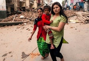Woman holds child during in front of wreckage, Nepal, April 25, 2014 | Photo courtesy of the Red Cross, St. George News