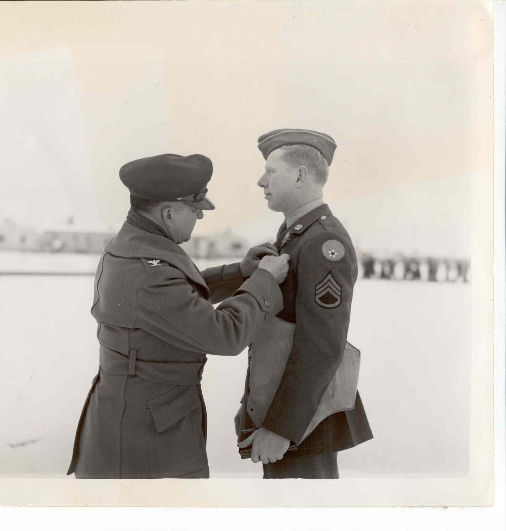 """Everett (Pete) Stults, a gunner in World War II, receiving a medal.  Photo provided to Orchestra of Southern Utah by Nina Hansen, daughter-in-law of Stults. Nina Hansen is principal cellist with the Orchestra of Southern Utah and perform """"Kol Nidrei"""" by Max Bruch at the performance previewed in the attached report.   Photo courtesy of Allen and Kristin Butt per Orchestra of Southern Utah, St. George News"""