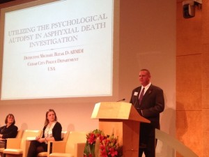 Mike Bleak presenting information about forensic autopsies versus phychological autopsies, APEAS Symposium, Paris, France, October, 2014 | Photo courtesy of Mike Bleak, St. George News