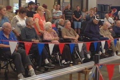 Veterans and guests watch as pinewood derby cars streak by, Ivins, Utah, April 18, 2015 | Photo by Ric Wayman, St. George News