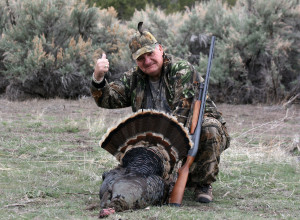Hunter holding their tom turkeys, location unspecified, November 19, 2013 | Photo courtesy of Utah Wildlife Resources, St. George News