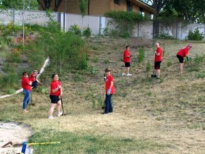 "Keller-Williams agents working to clear weeds as part of their ""Red Day"" at SwitchPoint Community Resource Center, St. George, Utah. Thursday, May 14, 2015 