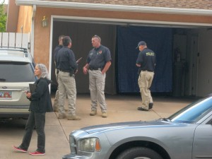 Police officers gather in the driveway of the missing girl's grandmother's house, St. George, Utah, Sunday May 24, 2015 | Photo by Ric Wayman, St. George News