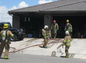 An afternoon fire damaged a garage in the 1900 block of South 2620 E. Circle but caused no injuries, St. George, Utah, May 25, 2015 | Photo by Ric Wayman, St. George News