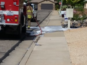 Santa Clara Fire Department responds to a bee colony in a water meter box, Santa Clara, Utah, May 14, 2015 | Photo by Julie Applegate, St. George News