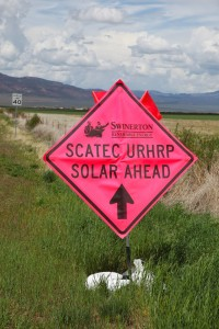 A sign points the way to a new solar power installation outside of Parowan | Photo by Corey McNeil, St. George News