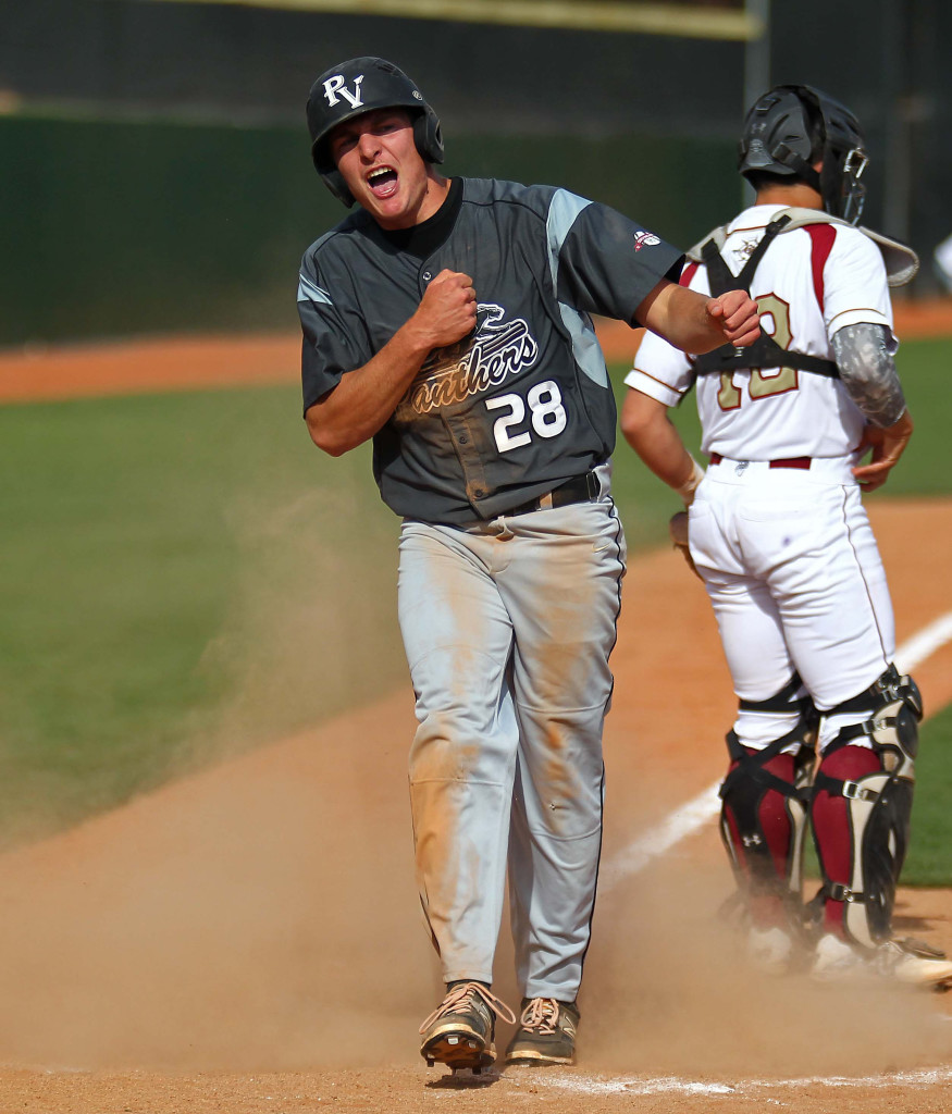 Blake Ence (28) reacts after scoring a run for the Panthers, Pine View vs. Cedar, Baseball, St. George, Utah, May 15, 2015 | Photo by Robert Hoppie, ASPpix.com, St. George News
