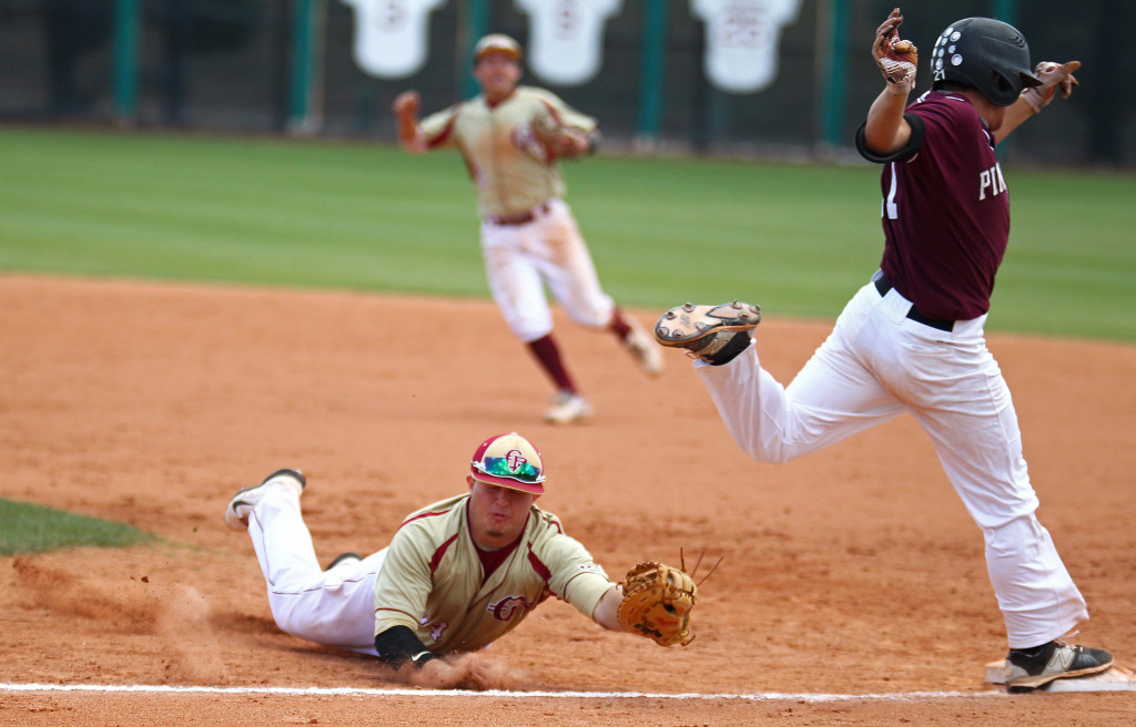 Cedar first baseman Brecken Lewis dives to tag Pine View's Brooks Barney, Barney avoided the tag and was called safe, Pine View vs. Cedar, 3A State Baseball Championship Game, St. George, Utah, May 16, 2015 | Photo by Robert Hoppie, ASPpix.com, St. George News