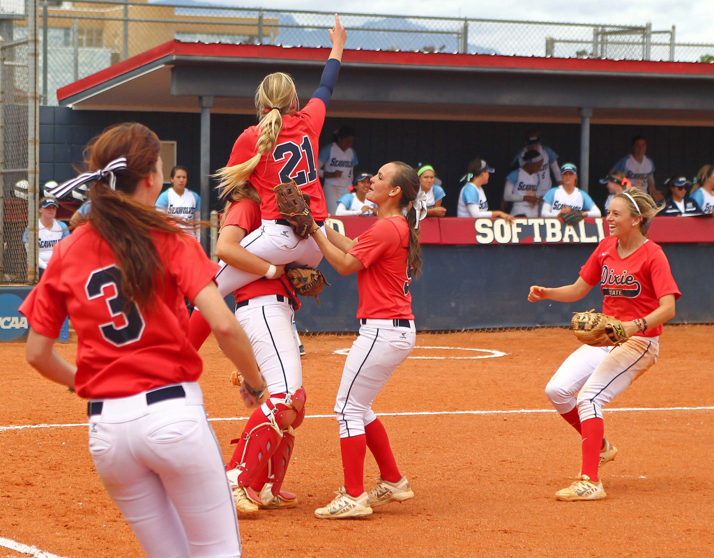 Dixie State players, including Michelle Duncan (21), celebrate their win in the Super Regional tournament, Dixie State University vs. Sonoma State University, Softball, St. George, Utah, May 16, 2015 | Photo by Robert Hoppie, ASPpix.com, St. George News