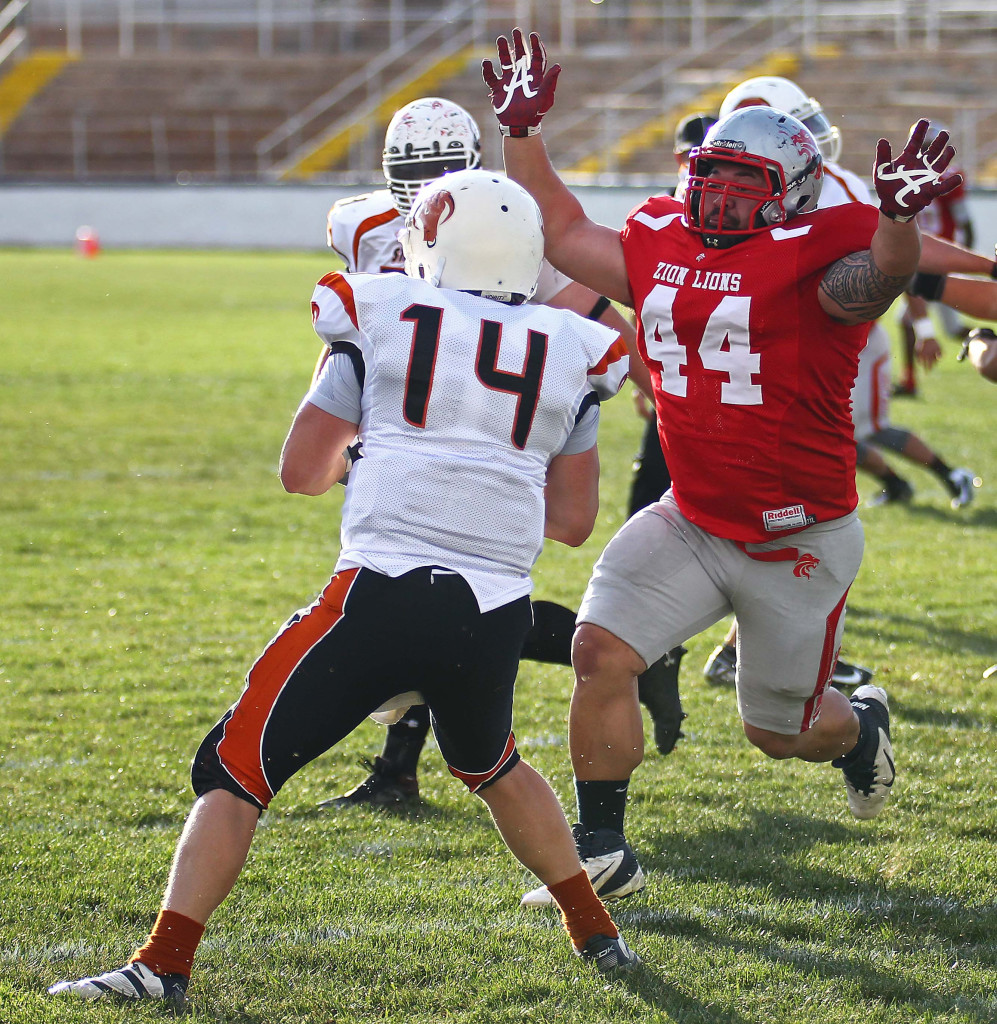 Zion's Joe Feula (44) puts pressure on the Logan quarterback,  Logan Stampede vs. Zion Lions, Football, St. George, Utah, May 2, 2015 | Photo by Robert Hoppie, ASPpix.com, St. George News