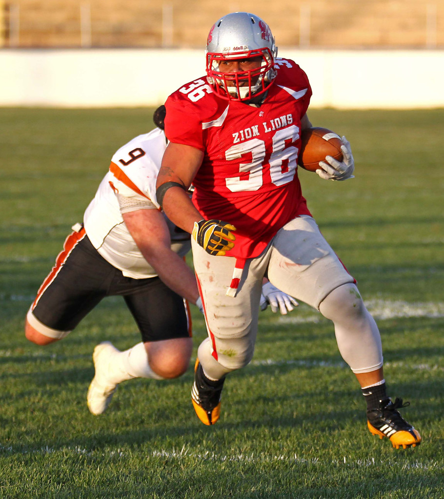 Sione Tapuosi (36) breaks out of a tackle and finds some yardage, Logan Stampede vs. Zion Lions, Football, St. George, Utah, May 2, 2015 | Photo by Robert Hoppie, ASPpix.com, St. George News