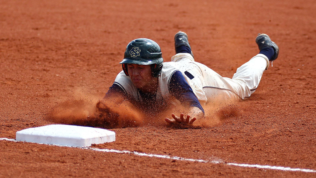 A Snow Canyon pinch runner dives safely in to third base, Snow Canyon vs. Payson, Baseball, St. George, Utah, May 14, 2015 | Photo by Robert Hoppie, ASPpix.com, St. George News