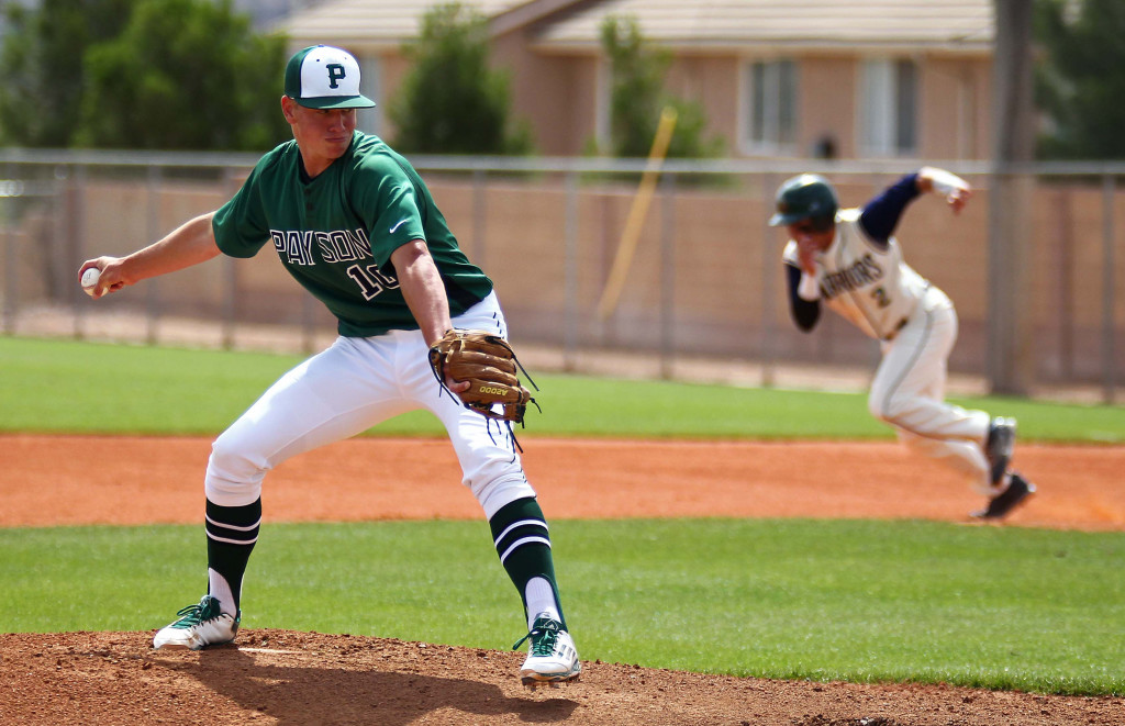 Payson pitcher Jayden Hartle (10) winds up while Snow Canyon base runner Nick Dolce (2) gets a jump on a steal attempt, Snow Canyon vs. Payson, Baseball, St. George, Utah, May 14, 2015 | Photo by Robert Hoppie, ASPpix.com, St. George News