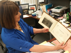 Dixie High School Principal Sharla Campbell shows a 1913 Dixie yearbook as an example of the schools long history, St. George, Utah, May 19, 2015 | Photo by Julie Applegate, St. George News