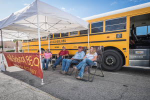 (L-R) Skeeter Allen, Terry Bellow, Doug Rucker and Shandi Rucker lounge in front of the Old School BBQ Bus.