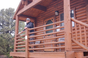 Recreation manager, Jake Millard, pauses to enjoy the view from one of the Cabin Suites at Zion Ponderosa Ranch Resort, Mount Carmel, Utah, May 18, 2015 | Photo by Hollie Reina, St. George News
