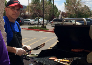 Smith's Food and Drug Employees Scott Simpson barbecues burgers for Primary Children's Hospital, 633 S Main St, Cedar City, Utah, May 2, 2015 | Photo by Carin Miller, St. George News
