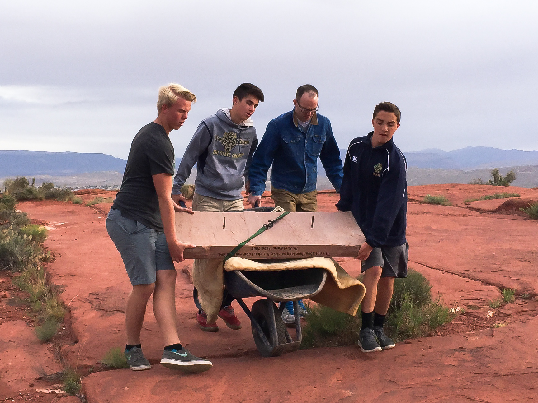 L-R: Jacob Brostrom, Andy Day, James Day, Taylor Hill, of Boy Scout Troop 1827, transporting bench in memorial to Dr. Paul Navar, who died of a heart attack on Paradise Rim in February, 2009. St. George, Utah, May 22, 2015 | Photo courtesy of Julie Day, St. George News