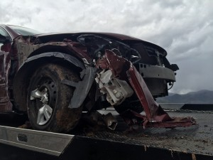 Car hydroplanes and spins on Interstate 15, Milepost 39, New Harmony, Utah, May 14, 2015 | Photo by Carin Miller, St. George News