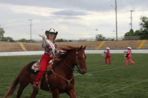 McKinley Drake, 2015 Dixie Round-up Rodeo Princess, rides around the Sunbowl to celebrate her coronation, St.George, Utah, May 7, 2015 | Photo by Nataly Burdick, St. George News
