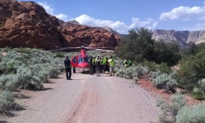 Members of Ivins Fire and Rescue and the Washington County Sheriff's Search and Rescue team deliver  an injured hiker to a waiting Life Flight helicopter for medical transport, Snow Canyon State Park, Utah, May 6, 2015 | Photo courtesy of Bart Bailey, St. George News