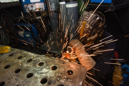 Hull Maintenance Technician 3rd Class Forrest Ebell, of St. George, performs functional test on a scud welder in the repair shop of USS John C. Stennis - CVN 74, Pacific Ocean, May 7, 2015   Photo by Mass Communication Specialist Seaman Kenneth Rodriguez Santiago, St. George News