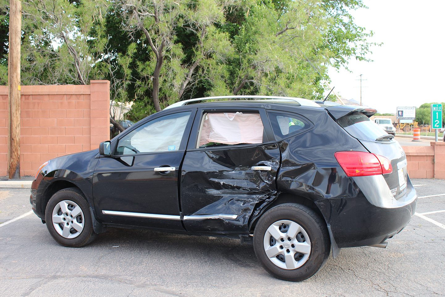 Damage to a vehicle involved in a three-vehicle collision on State Street, Laverkin, Utah, May 11, 2015 | Photo by Nataly Burdick, St. George News