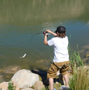 Young boy casting his line while fishing, location and date unspecified | Photo courtesy of Division of Wildlife Resources, St. George News